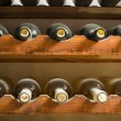 Wine bottles on shelf — Stock Photo