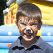 Child with painted face — Stock Photo
