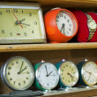 Old clocks on a shelf — Stock Photo