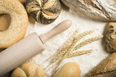 Breads. Pile of flour, rolling pin and wheat — Стоковое фото