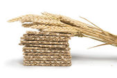 Pile Crackers and wheat cereal crops — Stock Photo