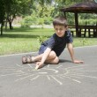 Stock Photo: Child drawing on asphalt