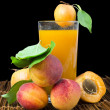 Glass apricot juice and fruits black isolated. — Stock Photo #31969167