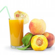 Peaches and glass with juice — Stock Photo
