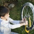 Kid who fix bikes — Stock Photo