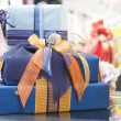 Blue Gift boxes in shopping center — Stock Photo #34214619