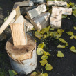 Ax chopping wood on chopping block — Stock Photo #34214909