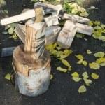 Ax chopping wood on chopping block — Stock Photo #34215059