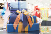 Blue Gift boxes in shopping center — Stock Photo