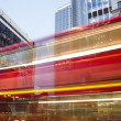 Red Bus in motion in City of London — Stock Photo #36651561