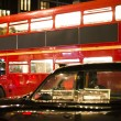 Red vintage bus and classic style taxi in London. — Stock Photo #36651825