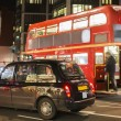 Red vintage bus and classic style taxi in London. — Stock Photo