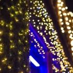Christmas lights in shopping center — Stock Photo