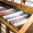 Ties stacked on a shelf in a store — Stock Photo
