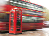 Red Phone cabine and bus in London. — Stock Photo