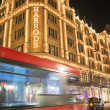 Harrods department store. Red bus passes in front of buildin — Stock Photo #37172807