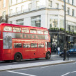 Stock Photo: London tour red touristic bus