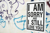 Text poster glued to the wall. I love You. — 图库照片