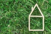 Model house made on green grass — Stock fotografie