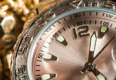 Shiny gold color watch — Stock Photo