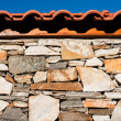 Wall built of stones. Sun light — Stock Photo