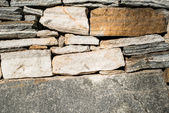 Wall built of stones. Sun light — Foto de Stock