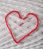 Knitted red heart on white — Stock Photo