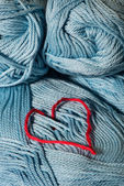 Knitted red heart on blue — Stock Photo