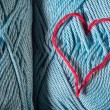 Stock Photo: Knitted red heart on blue