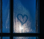 Moonlight through the window. Sweaty glass and heart — Stock Photo