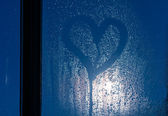 Moonlight through the window. Sweaty glass and heart — Стоковое фото