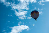 Multicolored Balloon in the blue sky — Stock Photo