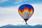 Multicolored Balloon in the blue sky — Stock fotografie