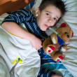 Sick child in bed with teddy bear — Foto Stock #40062701