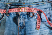 Jeans and centimeter — Stock Photo