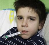Sick child in bed. — Stock Photo