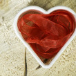 Heart shape made of red textile — Stock Photo