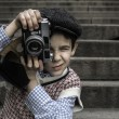 Child with vintage camera — Stok fotoğraf