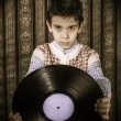 Stock Photo: Child hold lp