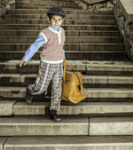Exterior stairs and child with vintage bag — Stock Photo