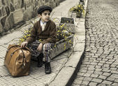 Child on a road with vintage bag — Stok fotoğraf
