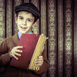Child with red vintage book — Stock Photo