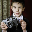 Child taking pictures with vintage camera — Stock Photo