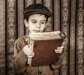 Child with red vintage book — Zdjęcie stockowe