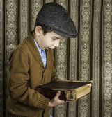 Child with red vintage book — Foto Stock