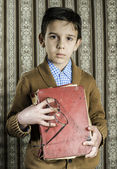Child with red vintage book — Stok fotoğraf