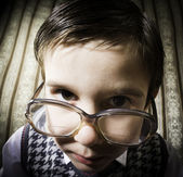 Smiling child with glasses in vintage clothes — Stock Photo