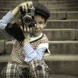 Child with vintage camera — Stock Photo