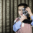 Stock Photo: Child taking pictures with vintage camera