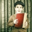 Stock Photo: Child with red vintage book